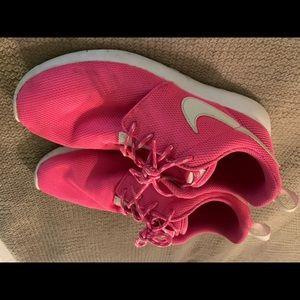 Pink nike running shoe
